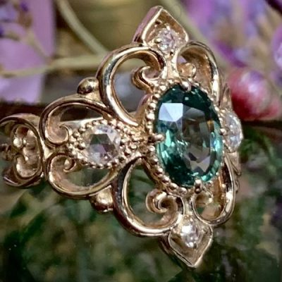 The Enchanted Forest Ring with Green Sapphire and Diamonds